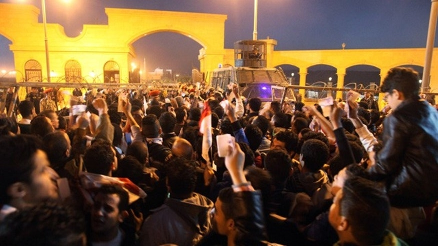 Feb. 8, 2015: Fans of Egypt's Zamalek soccer team flock in droves outside the Air Defense Stadium to watch a match between Egyptian Premier League clubs Zamalek and ENPPI in a suburb east of Cairo. (AP Photo/Ahmed Abd El-Gwad, El Shorouk newspaper)