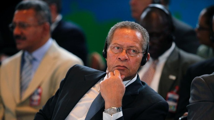"FILE - In this June 12, 2009 file photo, Jamaica's Prime Minister Bruce Golding listens to a speech during the Petrocaribe Summit, in Frigate Bay, St. Kitts. The former prime minister testified Monday, Feb. 9, 2015, that he personally knew the underworld boss Christopher ""Dudus"" Coke who ran a notorious slum fiefdom from his parliamentary constituency but stopped communicating with him roughly three years before the U.S. sought his extradition. (AP Photo/Brennan Linsley, File)"