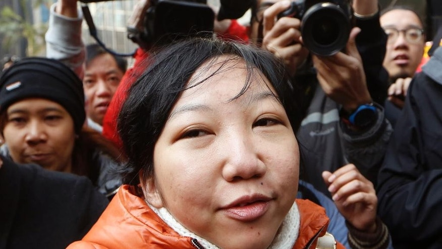 Indonesian maid Erwiana Sulistyaningsih arrives at a court in Hong Kong, Tuesday, Feb. 10, 2015. A Hong Kong woman who was accused of torturing her Indonesian maid in a case that sparked outrage for the scale of its brutality was convicted of a slew of assault and other charges on Tuesday. A judge found Law Wan-tung guilty of 18 charges that also included criminal intimidation and failure to pay wages or give time off work to Sulistyaningsih.(AP Photo/Kin Cheung)