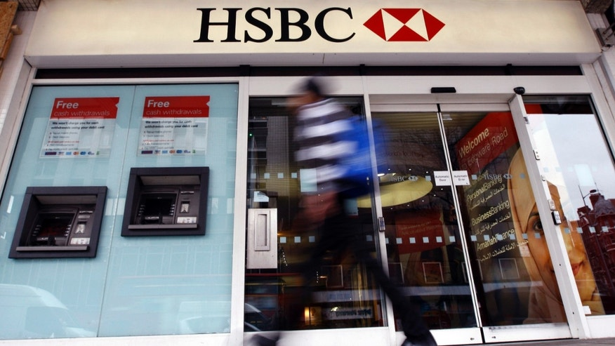 "FILE - In this Feb. 27, 2012 file photo, a pedestrian passes a branch of HSBC bank in London. The chair of parliaments Public Accounts Committee says the former chief of HSBC must face serious questions after once-secret papers outlined how the bank helped the wealthy dodge taxes. Margaret Hodge told the BBC on Monday, Feb. 9, 2015 that Stephen Green, HSBCâs former CEO, was either ""asleep at the wheel, or he did know and he was therefore involved in dodgy tax practices."" (AP Photo/Kirsty Wigglesworth, File)"