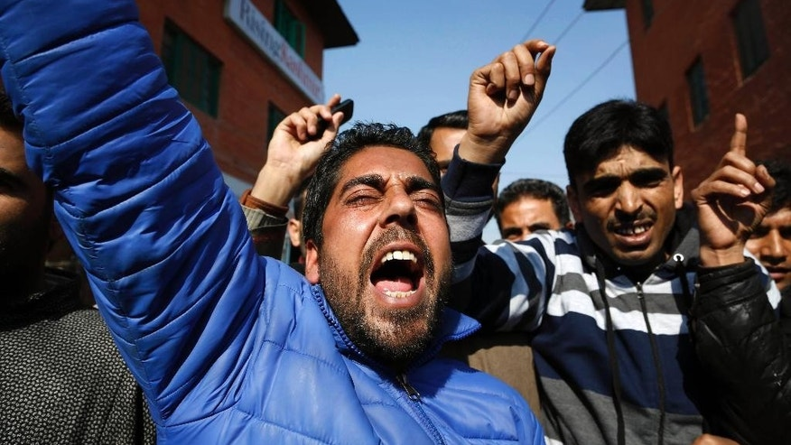 Activists of Awami Itihaad party shout slogans during a protest in Srinagar, India, Monday, Feb. 9, 2015. Hundreds of armed police and paramilitary soldiers are patrolling the disputed region of Kashmir where anti-India separatists called a strike to protest the secret execution two years ago of a former Kashmiri rebel and medical student Mohammed Afzal Guru. Many in this mostly Muslim region believe Guru was not given a fair trial on charges of involvement in 2001 Parliament attack that killed 14 people, including five gunmen. (AP Photo/Mukhtar Khan)
