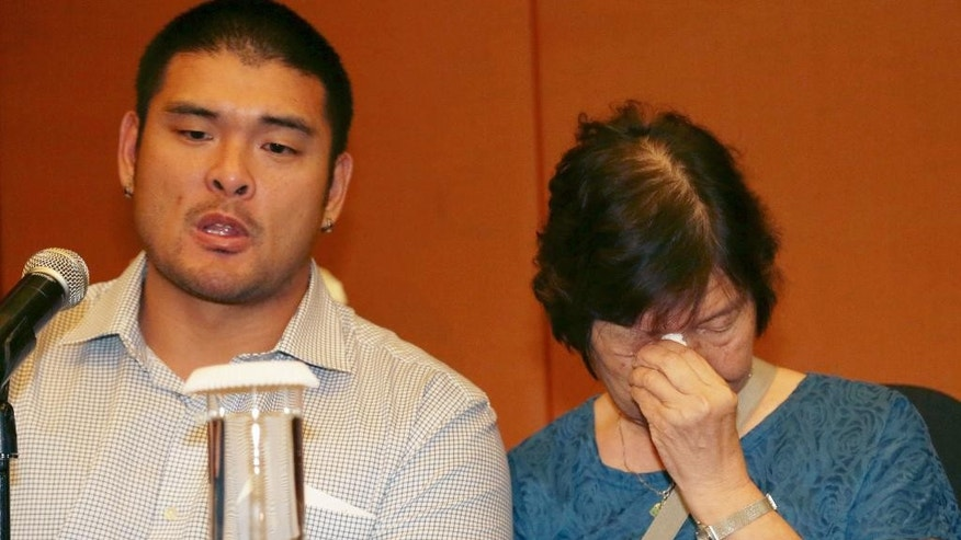 Michael Chan, left, and Helen Chan, the brother and mother of condemned Australian Andrew Chan, attend a press conference in Jakarta, Indonesia, Monday, Feb. 9, 2015. Lawyers representing two Australians, Chan and Myuran Sukumaran, who are expected to be executed later this month on drug smuggling charges, are preparing a last chance effort to spare their lives from Indonesian firing squad. The two are the ringleaders of a group of nine Australians who were arrested in 2005 for attempting to smuggle 8.3 kilograms (18.3 pounds) of heroin to their home country from the tourist island of Bali. (AP Photo/Achmad Ibrahim)