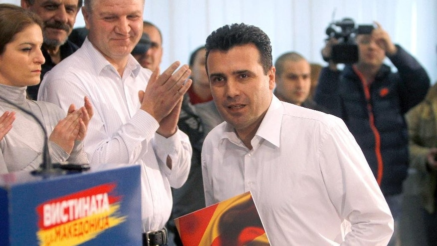 Zoran Zaev, the leader of the opposition Social-Democratic Alliance of Macedonia, arrives for a news conference in the party headquarters in Skopje, Macedonia, Monday, Feb. 9, 2015.  Zaev has accused the conservative government of carrying out illegal wiretaps on more than 20,000 people, including his own, and accused conservative Prime Minister Nikola Gruevski of heading the alleged surveillance operation. (AP Photo/Boris Grdanoski)
