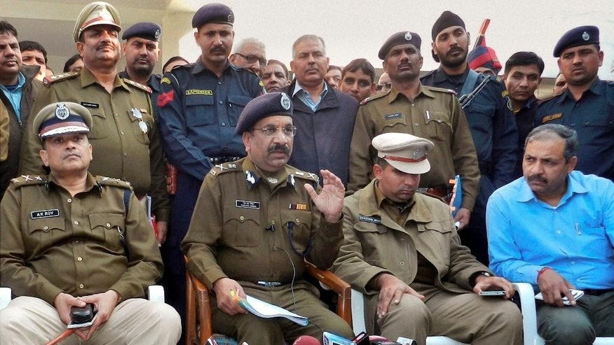 Indian police officers address the media as they announce the arrest of eight men suspected of brutally raping and killing a Nepalese woman in Rohtak, Haryana state, India, Monday, Feb. 9, 2015. Police were also searching Monday for a man who raped a Japanese student sightseeing in northern India, as authorities continue to struggle with a spate of attacks on women. (AP Photo/Press Trust of India) INDIA OUT