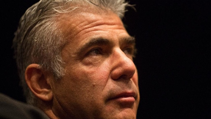 "In this photo taken Tuesday, Feb. 3, 2015, Yair Lapid, Israeli former finance minister and leader of Yesh Atid party, or ""There's a Future,"" speaks at the Israel Democracy Institute in Jerusalem. Had he played his cards differently, Lapid might be making a serious run now to become Israel's next prime minister. Instead, today the telegenic ex-anchorman, actor and novelist is hoping simply not to become Israel's next political flash in the pan. (AP Photo/Ariel Schalit)"