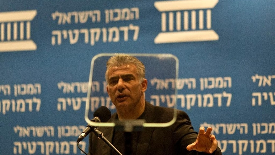 "In this photo taken Tuesday, Feb. 3, 2015, Yair Lapid, Israeli former finance minister and leader of Yesh Atid party, speaks at the Israel Democracy Institute in Jerusalem. His party, Yesh Atid or ""There's a Future,"" came from nowhere in the 2013 election to capture 19 of the Knesset's 120 seats, second only to Prime Minister Benjamin Netanyahu. But instead of leading his largely secular and middle-class supporters into opposition to battle Netanyahu, he cut a Faustian bargain with his right-wing rival and kept him in power, wilting his own grass roots in the process. (AP Photo/Ariel Schalit)"