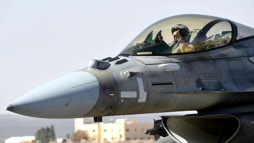 This photo released by WAM, the state news agency of the United Arab Emirates, shows an Emirati pilot in his F-16 at an air base in Jordan, Tuesday, Feb. 10, 2015. The United Arab Emirates launched airstrikes Tuesday targeting the Islamic State group, its official news agency said, marking its return to combat operations against the militants after it halted flights late last year. (AP Photo/WAM)