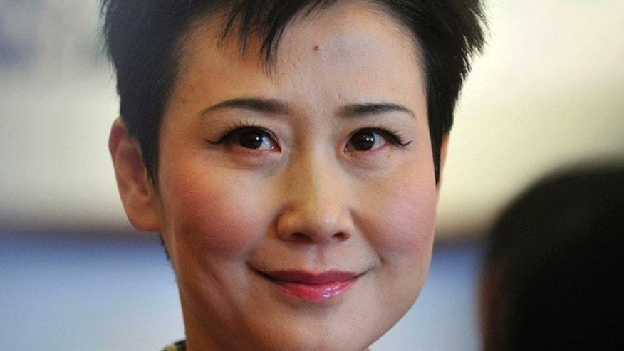 March 4, 2011: Li Xiaolin, chairwoman of the state-owned electricity giant China Power International Development Ltd., attends the Chinese People's Political Consultative Conference (CPPCC) in Beijing. Li, daughter of former Chinese Premier Li Peng, held as much as $2.48 million in a secret HSBC account in Switzerland, the International Consortium of Investigative Journalists has found. (AP Photo)