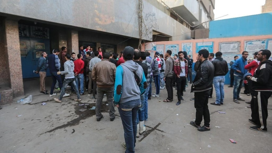 Feb. 9, 2015: Egyptian friends and relatives of soccer fans who were killed in a riot on Sunday, wait outside Zeinhom morgue, in Cairo, Egypt. (AP)
