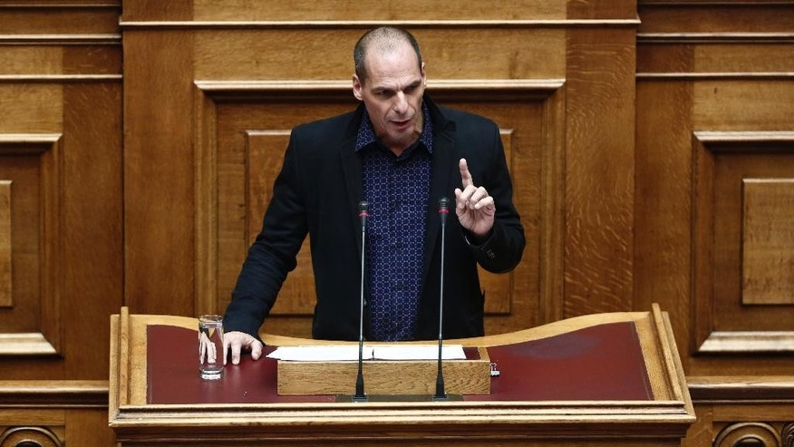 "Finance Minister Yanis Varoufakis speaks during a Parliament session in Athens, Monday, Feb. 9, 2015. Varoufakis dismissed the 240 billion euro ($270 billion) bailout packages crafted by Greece's lenders as a ""toxic fantasy"" that had always been doomed to fail. (AP Photo/Petros Giannakouris)"