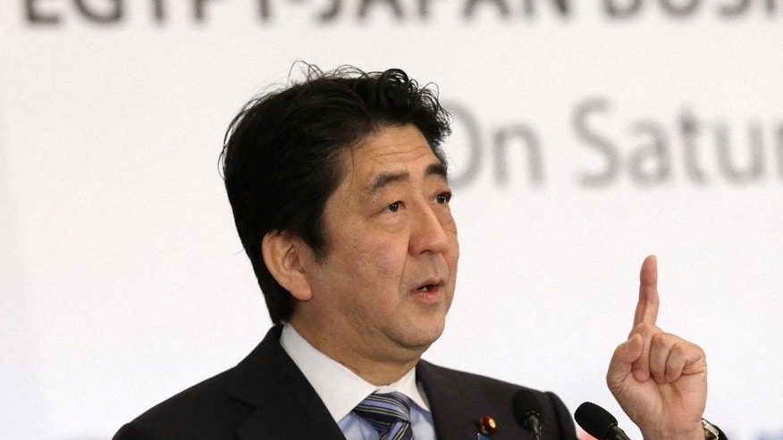 FILE - In this Jan. 17, 2015 file photo, Japanese Prime Minister Shinzo Abe speaks during a joint meeting of the Japan-Egypt business committee in Cairo, Egypt, when he pledged Japan's non-military support to the Middle East, including areas fighting against the Islamic State militants. Japan's outrage over the slaying of two Japanese hostages by the Islamic State group is settling into a heightened awareness of risks associated with the country's pursuit of lucrative energy projects and other economic ties in the Middle East. (AP Photo/Hassan Ammar, File)