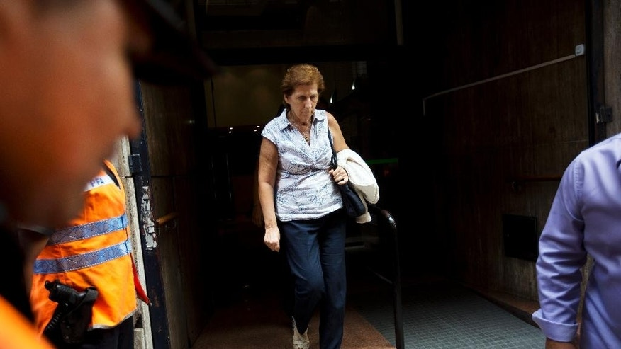 Sara Garfunkel, mother of late prosecutor Alberto Nisman, leaves the prosecutor's office that leads the investigation of the mysterious death of her son, after giving a statement in Buenos Aires, Argentina,Tuesday, Feb. 10, 2015. Nisman's mysterious death came as he was presenting allegations that Argentine President Cristina Fernandez had conspired to protect Iranian officials implicated in the 1994 bombing of a Jewish community center in which 85 people died. Fernandez and Iran have denied the allegations.  (AP Photo/Rodrigo Abd)