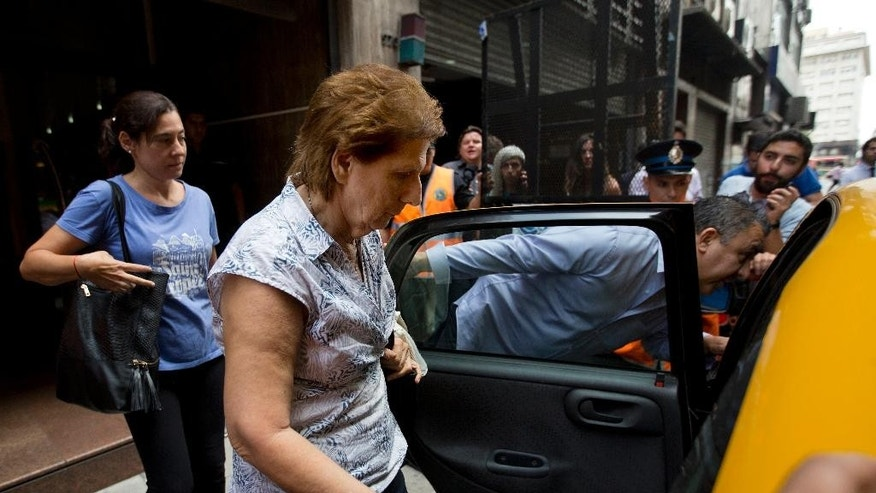 Sara Garfunkel, center, mother of late prosecutor Alberto Nisman, leaves the prosecutor's office that leads the investigation of the mysterious death of her son, after giving her statement to authorities, in Buenos Aires, Argentina,Tuesday, Feb. 10, 2015. Nisman's mysterious death came as he was presenting allegations that Argentine President Cristina Fernandez had conspired to protect Iranian officials implicated in the 1994 bombing of a Jewish community center in which 85 people died. Fernandez and Iran have denied the allegations. (AP Photo/Rodrigo Abd)