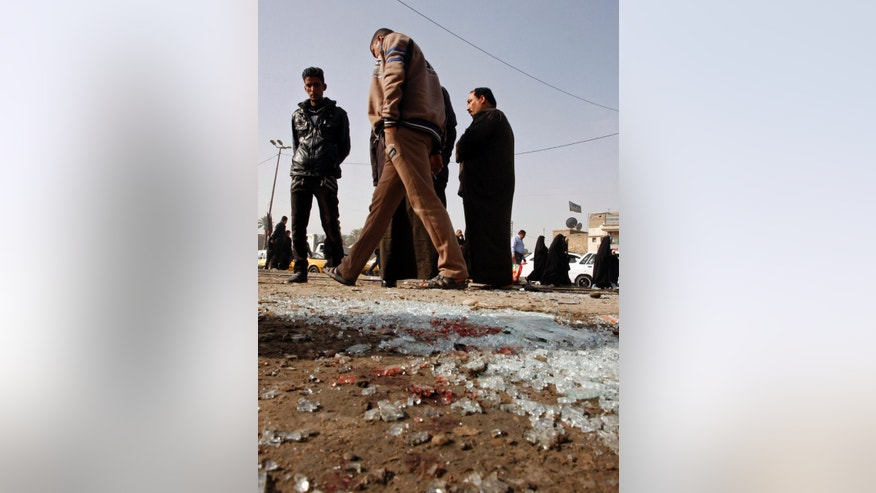 Broken glass remains at the scene of a suicide bomb attack at Adan Square, in a predominantly Shiite part of the capital, Baghdad, Iraq, Monday, Feb. 9, 2015. The attack and another in the northeastern suburb of Husseiniyah in Baghdad killed at least 20 people and wounded dozens on Monday, just days after the government lifted a nighttime curfew that had been in place in the Iraqi capital for over a decade. (AP Photo)