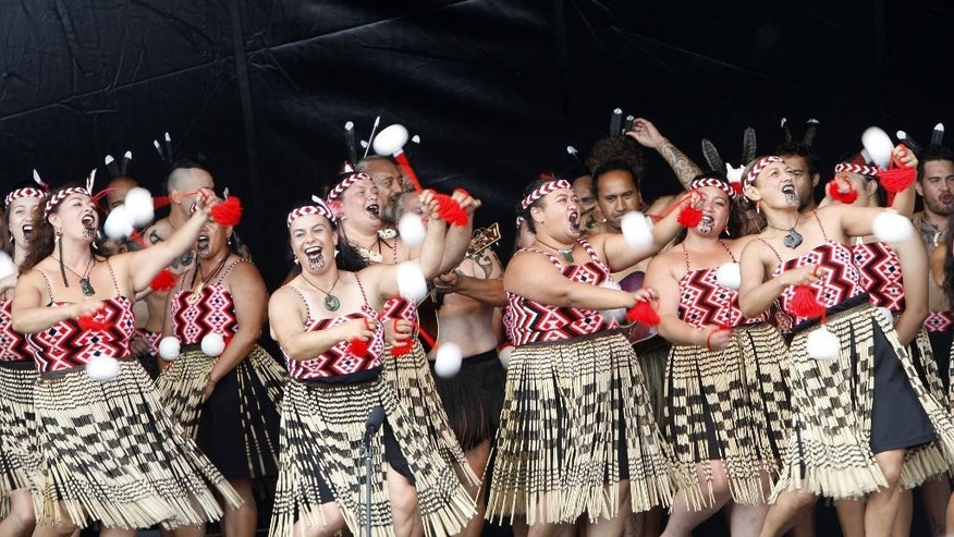 "In this Feb. 6, 2014 photo, dancers twirl white ""poi"" balls as part of an indigenous Maori performance in Waitangi, New Zealand. The nation celebrated the 175th anniversary of the signing of the Treaty of Waitangi, the country's founding document, over a three-day weekend. (AP Photo/Nick Perry)"