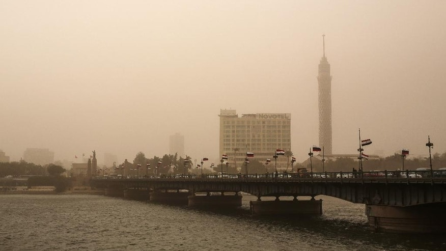 A general view of the Cairo Tower during a sandstorm in Egypt, Tuesday, Feb. 10, 2015. Egyptian officials say Cairo International Airport has been closed to arrivals amid a developing sandstorm. The sandstorm hit Egypt Tuesday after unusually warm and sunny weather for February. The sky over downtown Cairo turned yellow and blotted out the sun, limiting visibility. (AP Photo/Mosa'ab Elshamy)