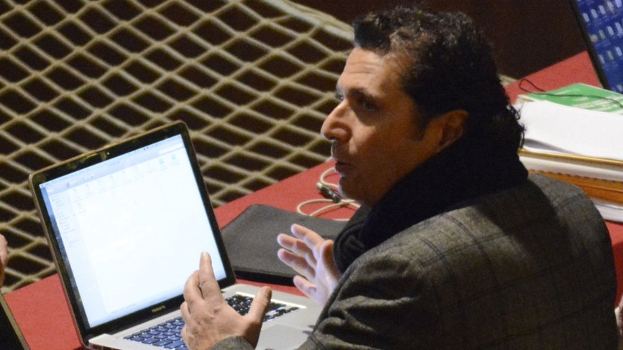 Feb. 10, 2015: Francesco Schettino sits in front of two laptops during a pause of his trial at the Grosseto court, Italy, Monday, Feb. 9, 2015.