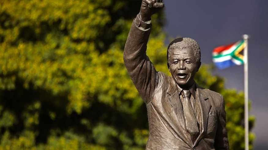 A statue of former South African President Nelson Mandela, with a raised fist, stands outside the former Victor Verster prison, renamed to Drakenstein Correctional center, near the town of Franschhoek, South Africa, Tuesday, Feb. 10, 2015.  On Feb. 11, 1990,  former South African President Nelson Mandela walked free from the Victor Verster prison with his then wife Winnie Madikizela-Mandela, with a raised fist in the air after being jailed for 27 years by the former South African Apartheid Government. Tomorrow marks the 25th anniversary of Mandela's release from prison. (AP Photo/Schalk van Zuydam)