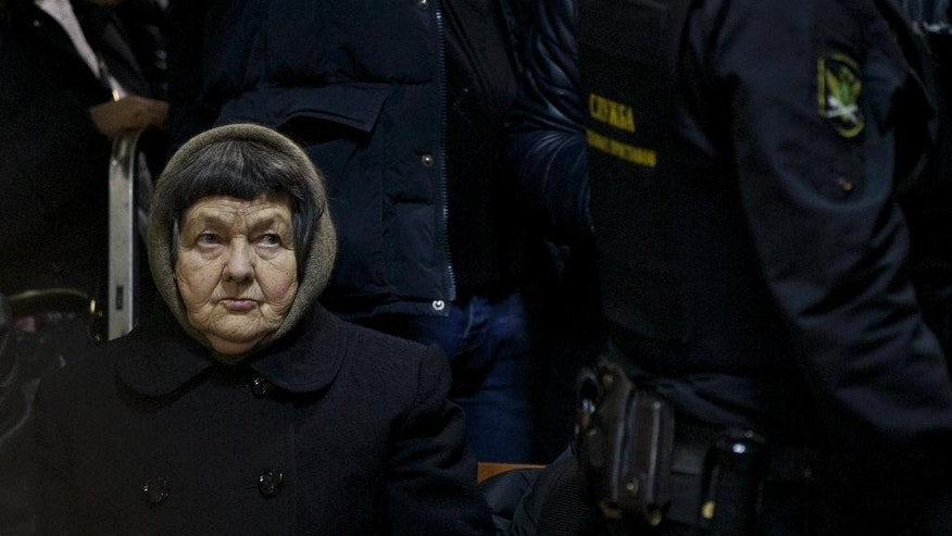 Maria, mother of military officer Nadezhda Savchenko sits in a court room in Moscow, Russia, Tuesday, Feb. 10, 2015. Ukrainian pilot Nadezhda Savchenko is awaiting trial in a Russian prison after she was captured by Russia-backed rebels during fighting in eastern Ukraine. Savchenko's lawyers challenged the judge on Tuesday. (AP Photo/Pavel Golovkin)