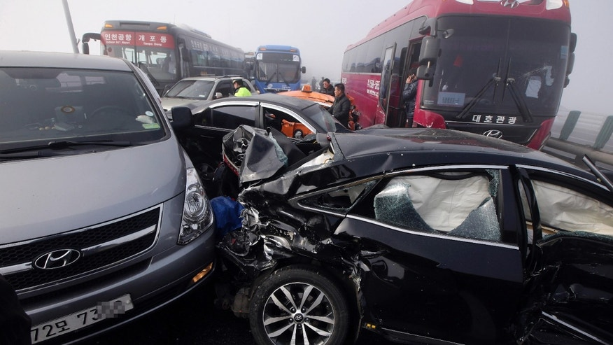 Feb. 11, 2015: Damaged vehicles sit on Yeongjong Bridge in Incheon, South Korea.