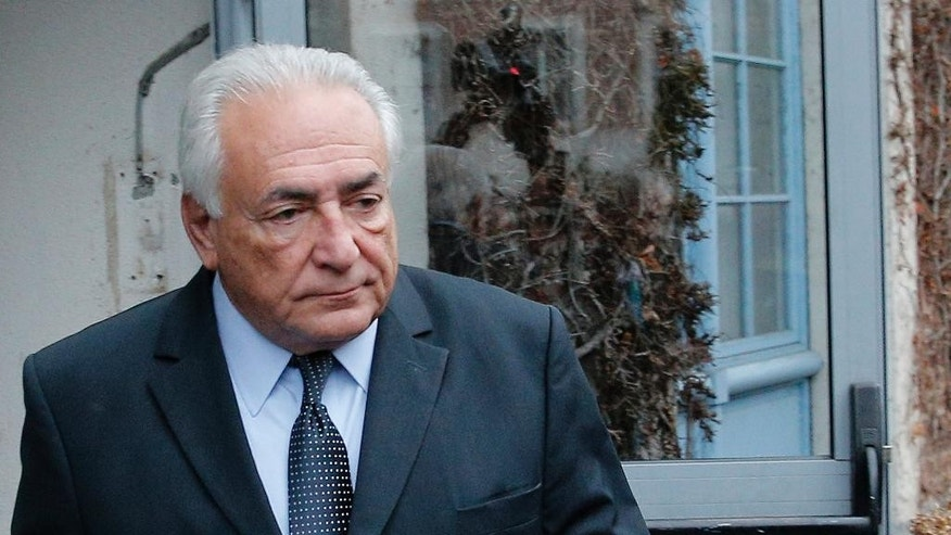 Former International Monetary Fund boss Dominique Strauss-Kahn leaves his hotel in Lille, northern France, Wednesday, Feb. 11, 2015 as he goes on trial for sex charges at a court. Strauss-Kahn sat nonchalantly with folded-arms and stretched legs Tuesday, before telling a French court he was completely unaware that women who participated in orgies at luxury hotels in Paris and Washington were prostitutes. (AP Photo/Christophe Ena)
