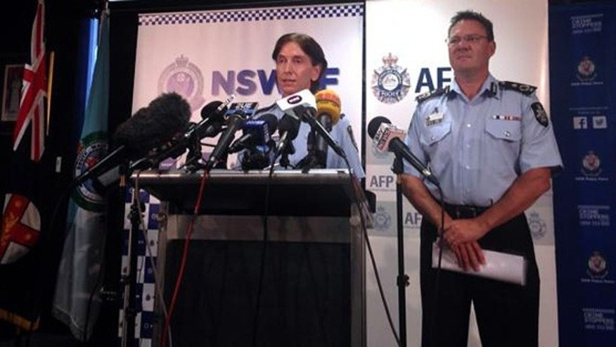 Feb. 11, 2015: Australian Federal Police Deputy Commissioner Michael Phelan, right, listens as New South Wales Deputy Police Commissioner Catherine Burn speaks during a media conference in Sydney. (Reuters/Lincoln Feast)