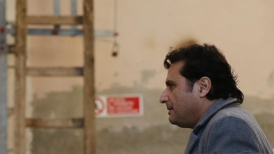Feb. 11, 2015: Francesco Schettino arrives to attend his trial at the Grosseto court, Italy. (AP)