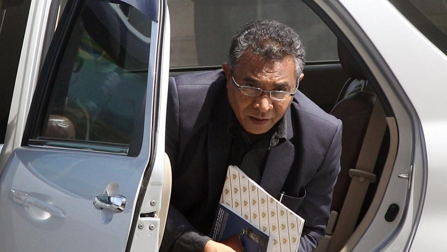 Former East Timorese health minister Rui Araujo steps out of his car prior to a meeting with President Taur Matan Ruak in Dili, East Timor, Wednesday, Feb. 11, 2015. Araujo was appointed as the country's new prime minister to replace independence hero Xanana Gusmao who resigned last week. (AP Photo/Kandhi Barnez)