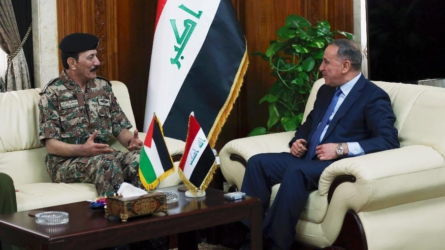 "The Chairman of the Joint Chiefs of Staff of the Jordanian armed forces, Lt. Gen. Mashal al-Zaben, left, meets with Iraqi Defense Minister Khalid al-Obeidi, right, at the Iraqi defense minister headquarters in Baghdad, Iraq, Wednesday, Feb. 11, 2015. Al-Zaben met with al-Obeidi and reiterated Jordan's ""support to Iraq in its war against the terrorist gangs,"" according to an official statement. (AP Photo/Karim Kadim)"