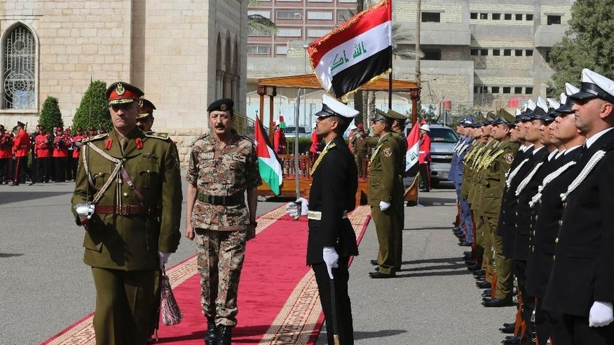 "The Chairman of the Joint Chiefs of Staff of the Jordanian armed forces, Lt. Gen. Mashal al-Zaben, center, inspects a guard of honor during a welcome ceremony at the Iraqi defense minister headquarters in Baghdad, Iraq, Wednesday, Feb. 11, 2015. Al-Zaben met with Iraqi Defense Minister Khalid al-Obeidi and reiterated Jordan's ""support to Iraq in its war against the terrorist gangs,"" according to an official statement. (AP Photo/Karim Kadim)"