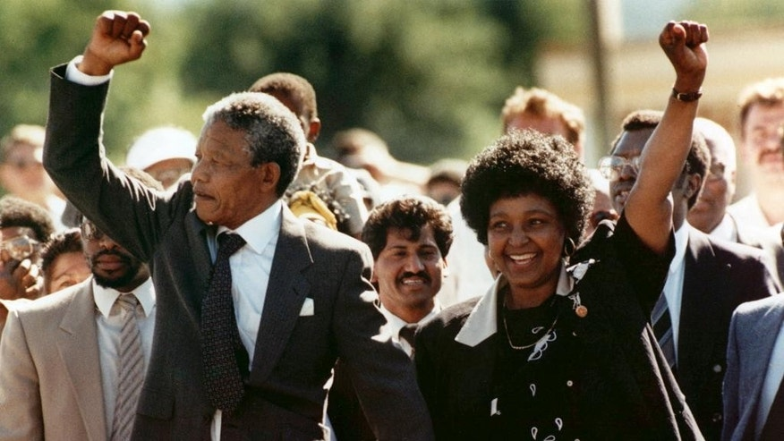 Feb. 11, 1990: In this file photo, Nelson Mandela, left, and his wife Winnie, raise clenched fists as they walk hand-in-hand from the Victor Verster prison near Cape Town, South Africa. (AP)
