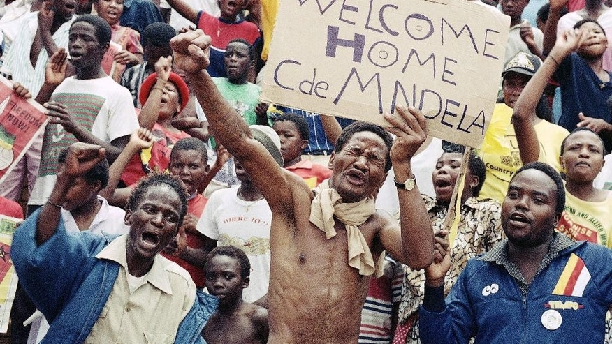 FILE - In this Feb. 11, 1990, file photo, supporters gather in Soweto to celebrate the release of Nelson Mandela in Cape Town, South Africa, Wednesday, Feb. 11, 2015. South Africans are marking the anniversary of the release of the country's first black president, Nelson Mandela, who was freed 25 years ago. Mandela was released on Feb. 11, 1990, after 27 years in prison. (AP Photo/Raymond Preston, File)