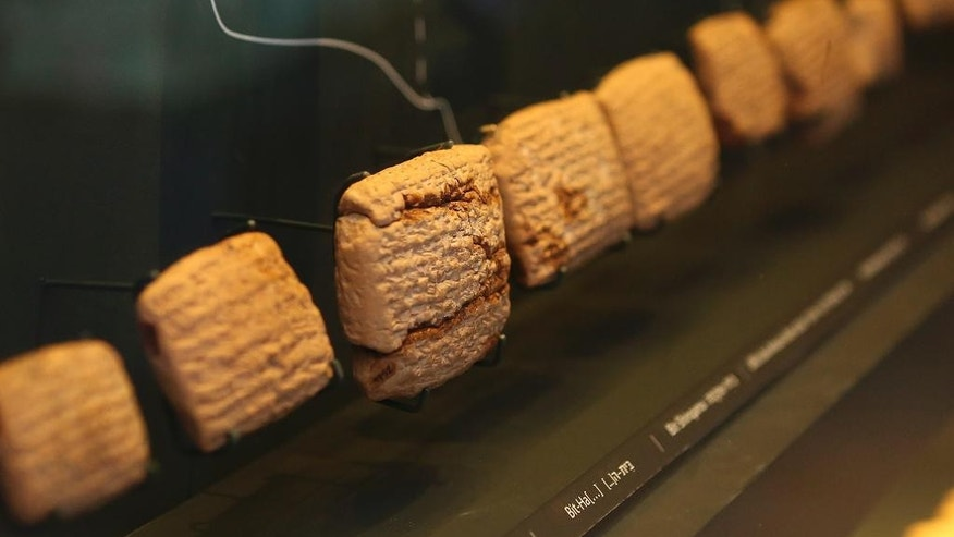 This undated photo provided by the Bible Lands Museum Jerusalem shows cuneiform, one of the world's earliest scripts, at display in Jerusalem. The tablets, which went on public display in February 2015 for the first time at the museum, provide the earliest written evidence of the Biblical exile of the Judeans in what is now southern Iraq, offering new insight into a formative period of early Judaism. (AP Photo/Avi Noam, Bible Lands Museum)