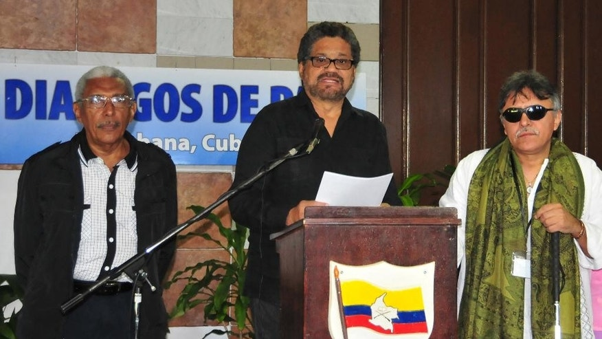 Ivan Marquez, chief negotiator for the Revolutionary Armed Forces of Colombia (FARC), center, accompanied by Jesus Santrich, right, and Joaquin Gomez, left, speaks at a news conference at the close of another round of peace talks with Colombia's government in Havana, Cuba, Thursday, Feb 12, 2015. (AP Photo/Ismael Francisco, Cubadebate)