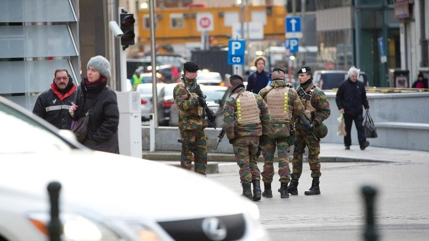 FILE - In this Monday, Feb. 2, 2015 file photo, Belgian soldiers patrol outside EU headquarters in Brussels. Galvanized by the recent terror attacks in France, European Union leaders on Thursday, Feb. 12, 2015 are debating a range of ambitious steps to better protect their 28 nations, including exchanging airliner passenger manifests, tightening controls at the border and combating extremism on the Internet. (AP Photo/Virginia Mayo, File)