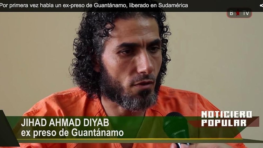 In this frame grab taken from Barricada TV, former Guantanamo detainee Abu Wa'el Dhiab, one of the Syrian refugees recently released from Guantanamo and now living in Uruguay speaks during an interview, in Buenos Aires Argentina, Wednesday Feb. 11, 2015. Dhiab said he was there to ask the the Argentine government to grant asylum to his former fellow inmates still being held at the U.S. prison facility in Cuba. (AP Photo/Barricada TV)
