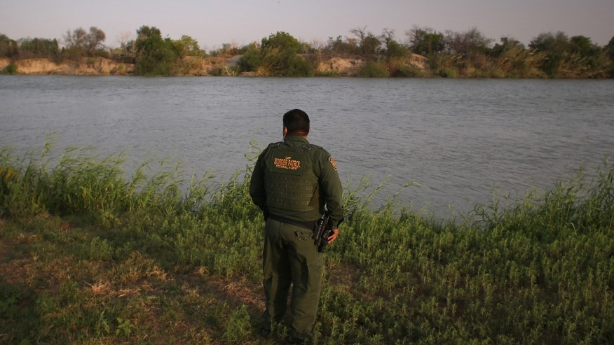 MCALLEN, TX - APRIL 10:  U.S. Border Patrol agent Sal De Leon looks across the Rio Grande River into Mexico at the U.S.-Mexico border while on patrol on April 10, 2013 in McAllen, Texas.  (Photo by John Moore/Getty Images)