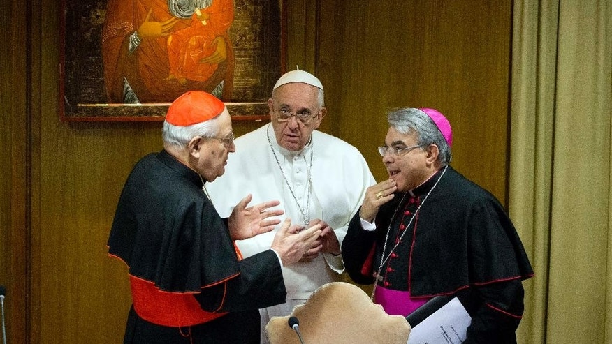 "Pope Francis talks with Cardinal Angelo Sodano, left, and archbishop Marcello Semeraro as they arrive for a special consistory with cardinals and bishops, in the Synod hall at the Vatican,  Thursday, Feb. 12, 2015. Pope Francis met with cardinals and bishops who will take part in the upcoming Feb. 14, 2015 consistory during which he will elevate 20 new cardinals. Pope Francis is urging his cardinals to cooperate with his reform of the outdated and dysfunctional Vatican bureaucracy, saying the overhaul will help him govern the 1.2-billion-strong Catholic Church better and spread the faith more effectively. Francis summoned cardinals from around the world to hear proposals for revamping the church's central government. The proposals include merging offices and reducing waste. Opening the meetings Thursday, Francis said the aim was to encourage greater harmony and collaboration in ""absolute transparency,"" to help the church spread the faith and reach out to others. (AP Photo/Andrew Medichini)"