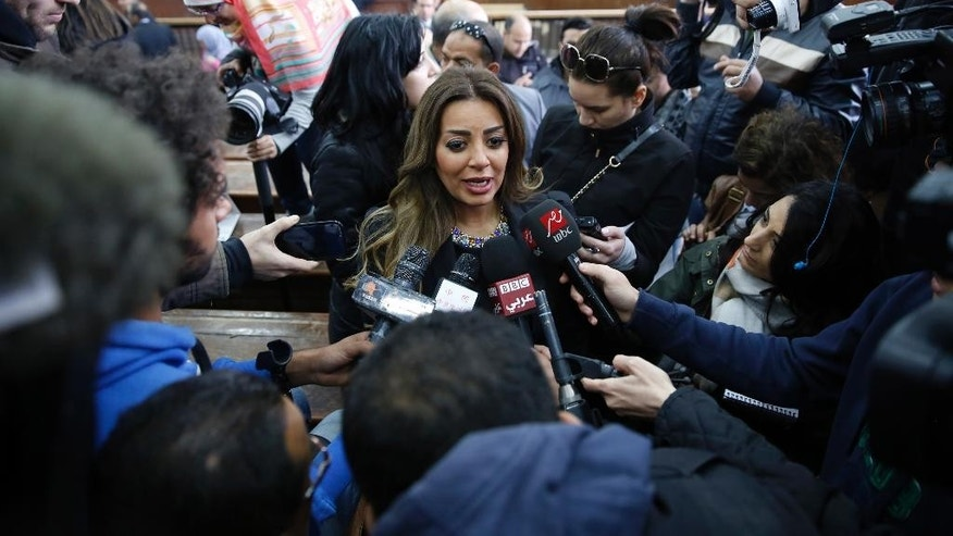 Marwa Omara, the fiancee of Al-Jazeera English journalist Mohammed Fahmy, talks to journalists in a courthouse near Tora prison in Cairo, Egypt, Thursday, Feb. 12, 2015. An Egyptian judge ordered Fahmy and another Al-Jazeera English journalist, Baher Mohammed, released on bail Thursday as their retrial on terror-related charges continues. (AP Photo/Hassan Ammar)