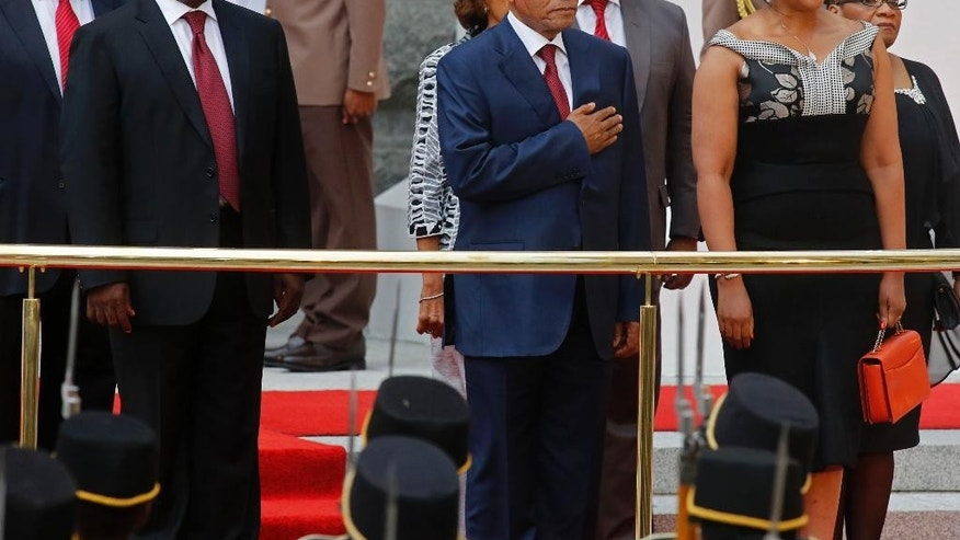 South African President Jacob Zuma, center,  at Parliament during the official opening session in Cape Town, South Africa, Thursday, Feb. 12, 2015. South African President Jacob Zuma will deliver the State of the Nation Address after the opening session of the South African Parliament.  (AP Photo/Schalk van Zuydam,Pool)