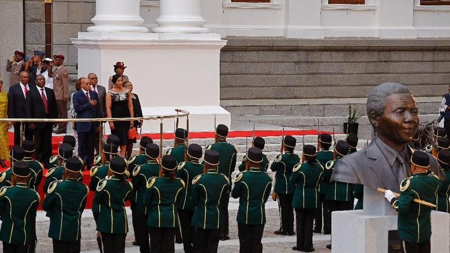 South African President Jacob Zuma, centre podium, at Parliament during the official opening session in Cape Town, South Africa, Thursday, Feb. 12, 2015. South African President Jacob Zuma will deliver the State of the Nation Address after the opening session of the South African Parliament.  (AP Photo/Schalk van Zuydam, Pool)