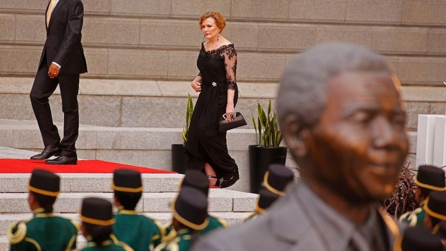 South African leader of the Democratic Alliance, DA, Helen Zille, walks toward the entrance of Parliament in Cape Town, South Africa, Thursday, Feb. 12, 2015. South African President Jacob Zuma will deliver the State of the Nation Address after the opening session of the South African Parliament.  (AP Photo/Schalk van Zuydam, Pool)