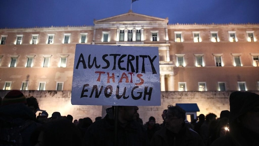 Pro-government protesters gather in front of Greece's parliament to back its demands of a bailout debt renegotiation in central Athens, Wednesday, Feb. 11, 2015. The protests held in Athens and by supporters of the left-wing Syriza party in several other European cities occurred as the new Greek government presented its proposals to skeptical rescue lenders at an emergency Eurogroup meeting in Brussels. (AP Photo/Yorgos Karahalis)