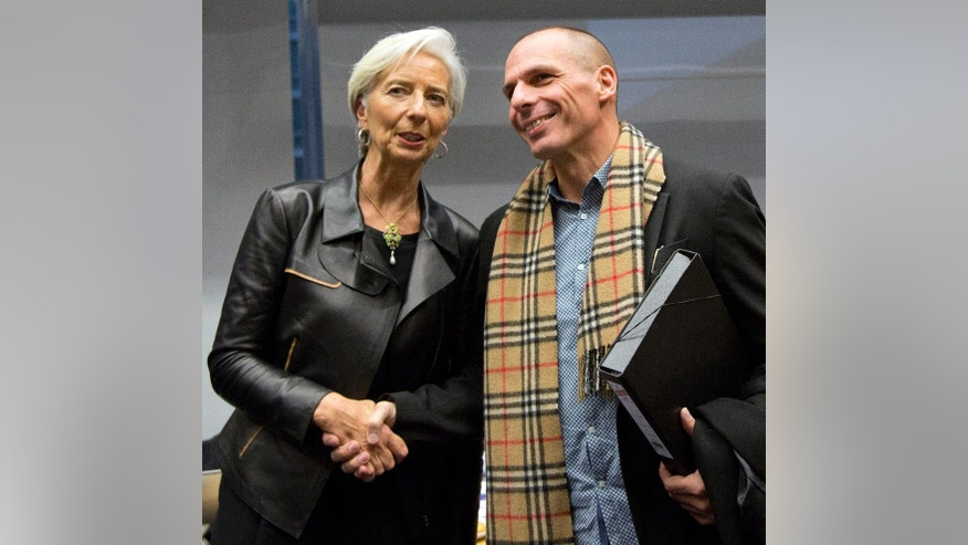 Managing Director of the International Monetary Fund Christine Lagarde, left, shakes hands with Greek Finance Minister Yanis Varoufakis during a meeting of eurogroup finance ministers in Brussels on Wednesday, Feb. 11, 2015. Leading European officials downplayed expectations that a comprehensive debt deal with Greece is likely Wednesday at an emergency meeting in which Greece's finance minister is set to unveil a plan to loosen austerity's grip on his economy. (AP Photo/Virginia Mayo)