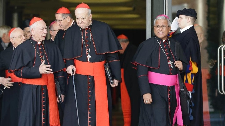 Soane Patita Paini Mafi, Archbishop of Tonga, right, leaves at the end of a special consistory with cardinals and bishops, in the Synod hall at the Vatican,  Thursday, Feb. 12, 2015. Pope Francis met with cardinals and bishops who will take part in the upcoming Feb. 14, 2015 consistory during which he will elevate 20 new cardinals. (AP Photo/Andrew Medichini)