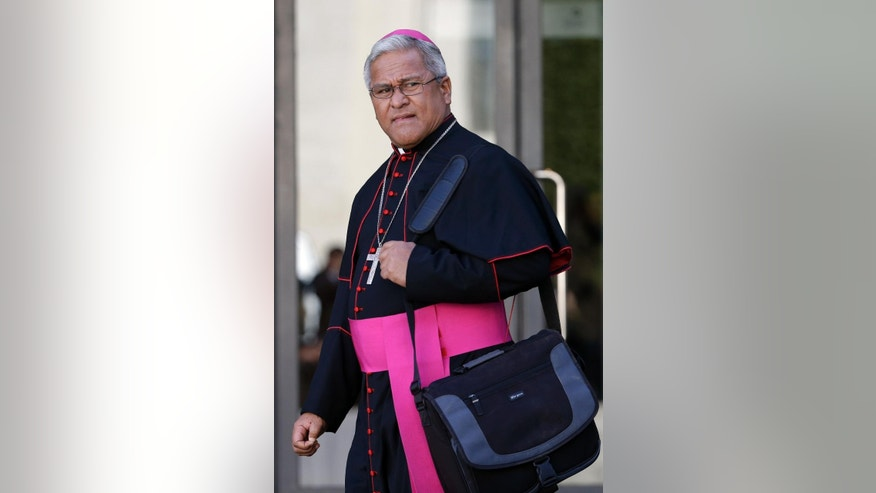Soane Patita Paini Mafi, Archbishop of Tonga, leaves at the end of a special consistory with cardinals and bishops, in the Synod hall at the Vatican,  Thursday, Feb. 12, 2015. Pope Francis met with cardinals and bishops who will take part in the upcoming Feb. 14, 2015 consistory during which he will elevate 20 new cardinals. (AP Photo/Andrew Medichini)