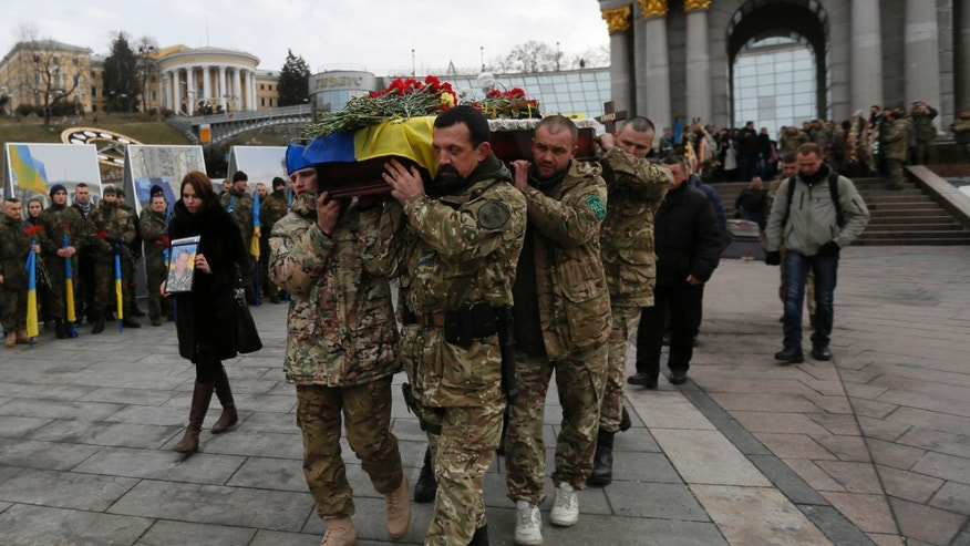 Feb. 2, 2015: Ukrainian soldiers carry the coffin bearing the body of serviceman Ruslan Baburov, who was killed in fighting against Russian-backed separatists.
