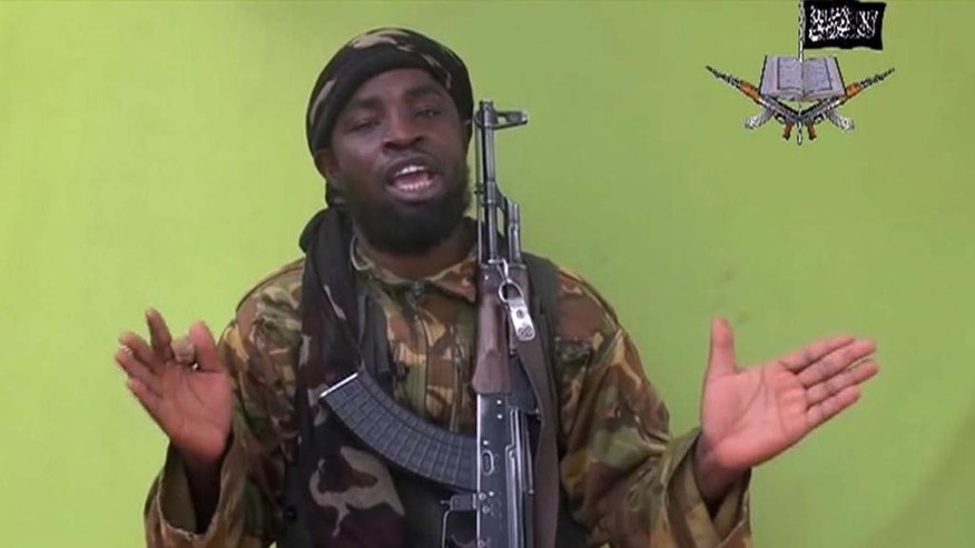 FILE - This is a Monday May 12, 2014 file photo taken from video by Nigeria's Boko Haram terrorist network, and shows their  leader Abubakar Shekau speaking to the camera. Suspected Boko Haram militants attacked a village on the shore of Lake Chad early Friday Feb. 13, 2015 marking the first such violence against the neighbor contributing the most military might to the regional fight against the Nigeria-based terror group. (AP Photo/File)