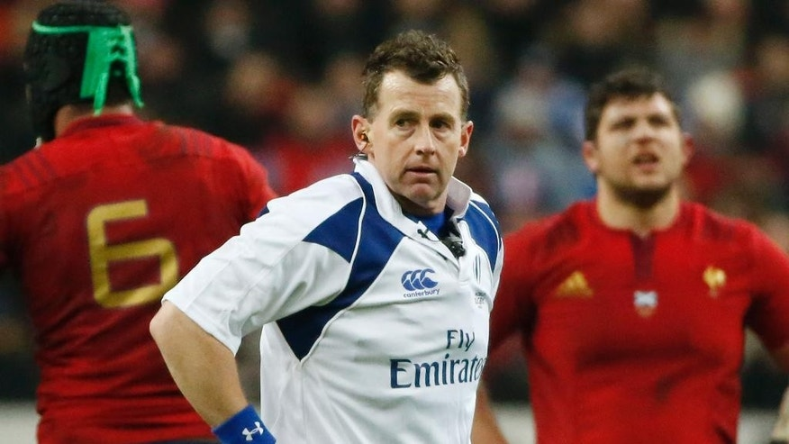 FILE - This Saturday Feb. 7, 2015, file photo shows referee Nigel Owens looking around during a Six-Nations rugby union international match between France and Scotland at the Stade de France stadium in Saint Denis, outside Paris, France. For Nigel Owens, it is no real surprise that so few others in professional sports have followed his lead and come out as gay. Society is ready to accept gay footballers and rugby players, but the athletes themselves are not, the rugby referee extraordinaire says in an Associated Press interview. (AP Photo/Michel Euler, File)