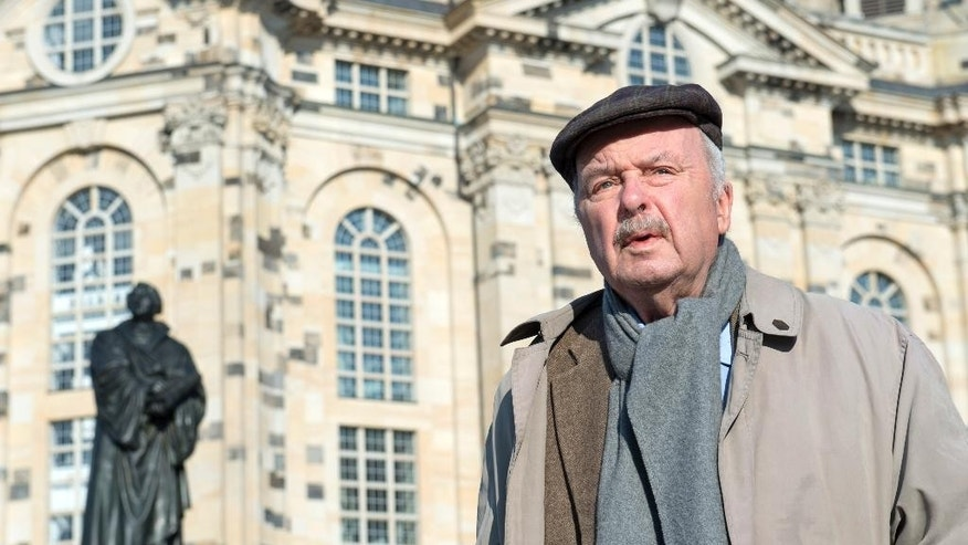 In this picture taken Thursday, Feb. 12, 2015, Eberhard Renner, born in Dresden in 1932, stands in front of the Frauenkirche cathedral (Church of Our Lady) during an interview one day before the 70th anniversary of the deadly Allied bombing of the cityt during WWII in Dresden, eastern Germany. British and U.S. bombers on Feb. 13-14, 1945 destroyed Dresden's centuries-old baroque city center. (AP Photo/Jens Meyer)
